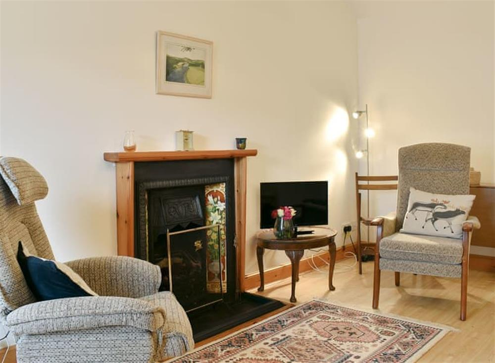 Comfortable living/ dining room at High Street Cottage in Aberlour, Highlands, Banffshire