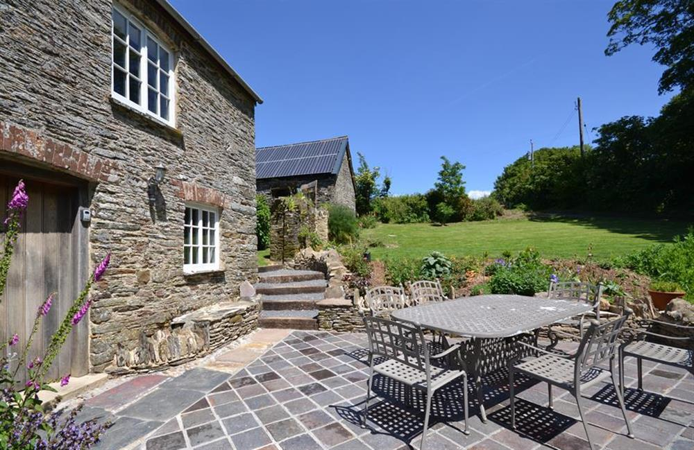Enjoy the sunny landscaped terrace. Perfect for al fresco dining at Higher Cotterbury Cottage, Blackawton