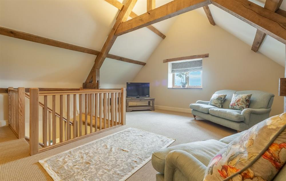 Fallow Folly first floor: Sitting room with three sofas, armchairs, reading/games area and Smart television