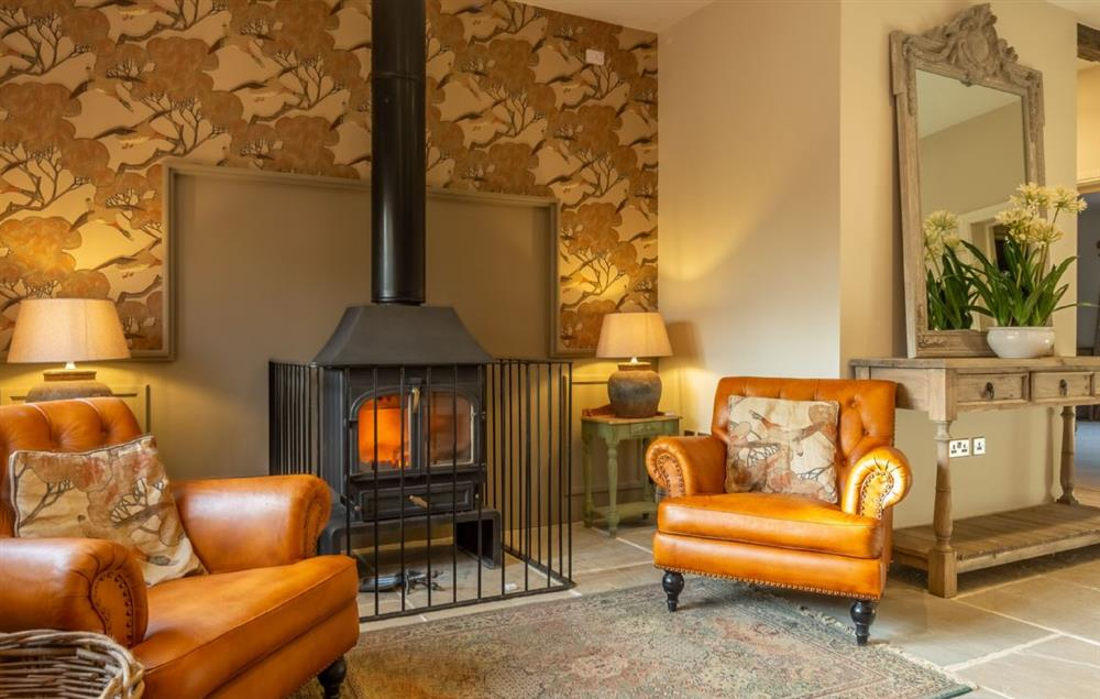 Red Stage Lodge ground floor: Open plan sitting room with wood burning stove