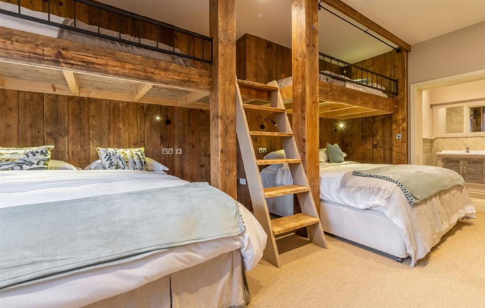 Red Stage Lodge ground floor: The Dorm with chalet-style, built-in bunk complex which can either be taken with two super king beds and two single top bunks, or as six single beds