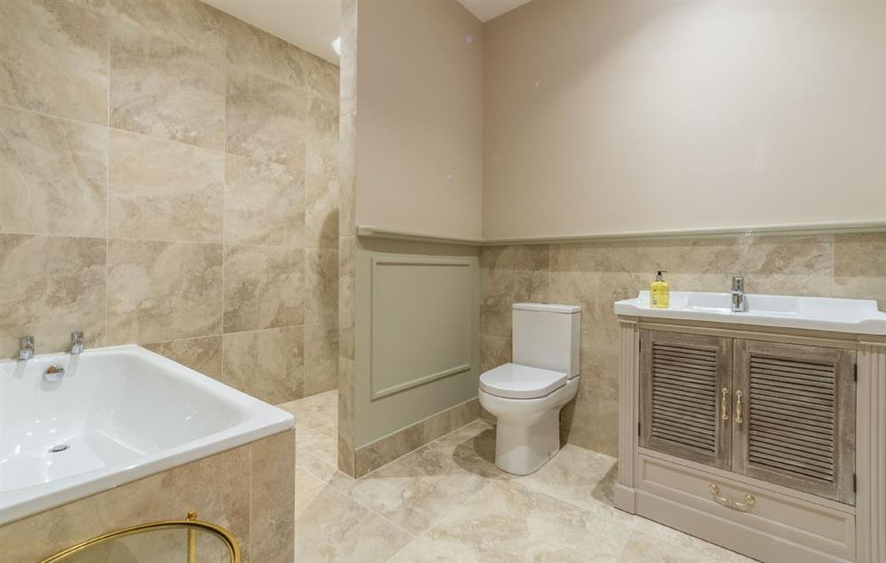 The Owl House ground floor: En-suite with bath, basin, deluxe shower and WC