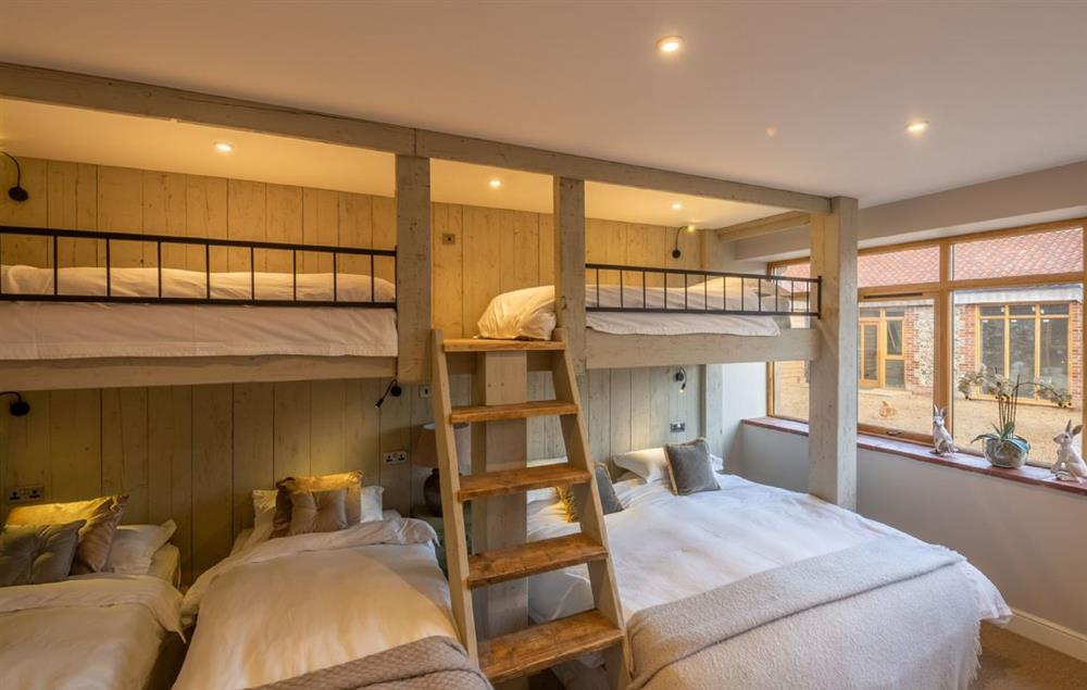 The Owl House ground floor: The Dorm with chalet-style, built-in bunk complex which can either be taken with two super king beds and two single top bunks, or as six single beds
