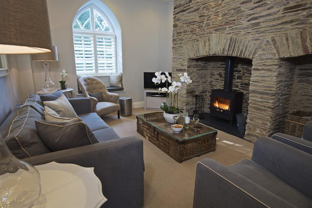 Cosy sitting room with double-fronted Inglenook fireplace at Hillfield Farmhouse in , Hillfield, Dartmouth
