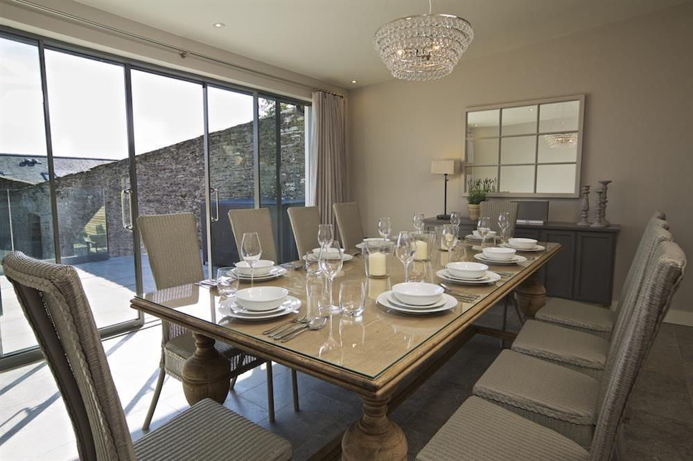Dining area with sliding doors to private terrace at Hillfield Farmhouse in , Hillfield, Dartmouth