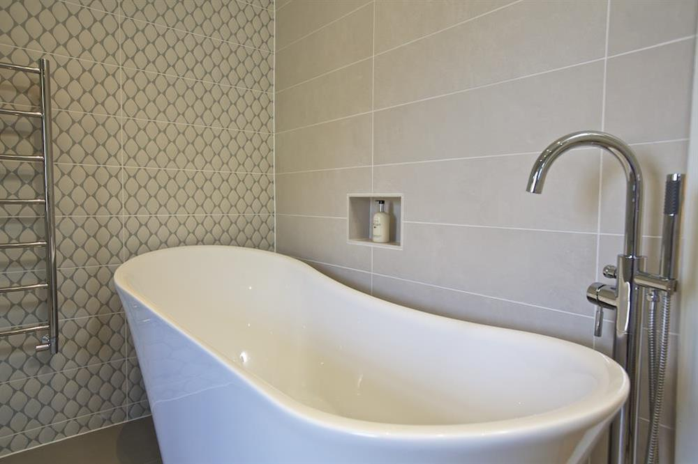 En suite bathroom with slipper bath and shower at Hillfield Farmhouse in , Hillfield, Dartmouth