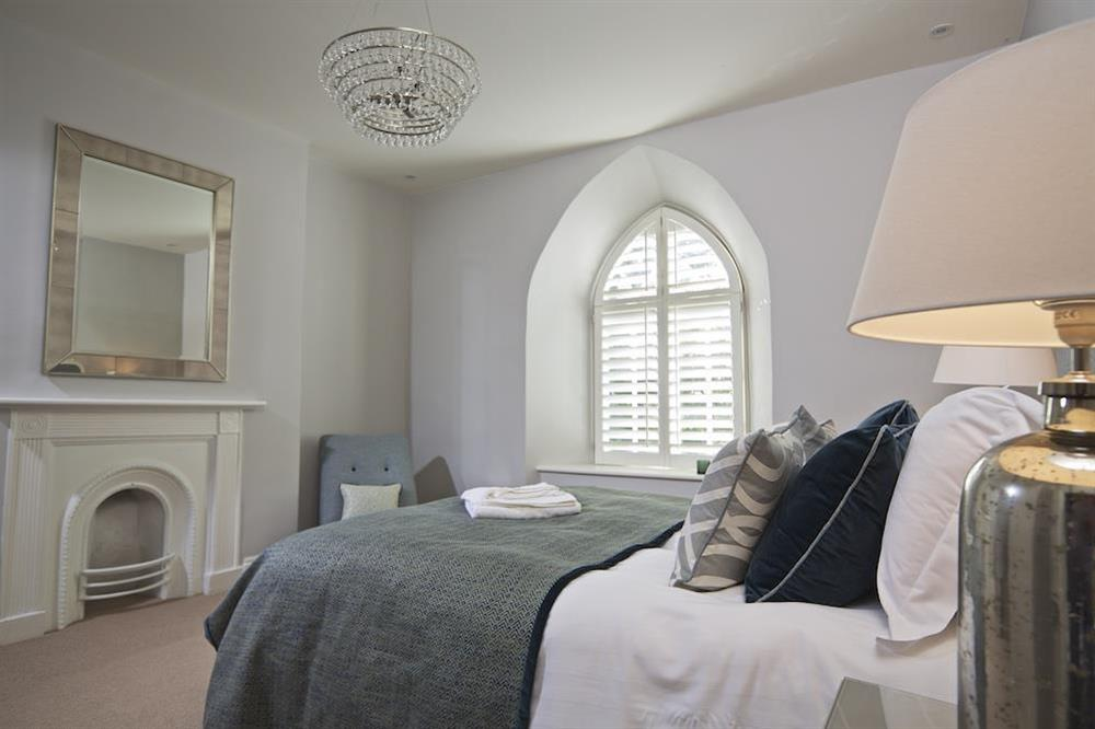 En suite double bedroom with elegant King size bed at Hillfield Farmhouse in , Hillfield, Dartmouth