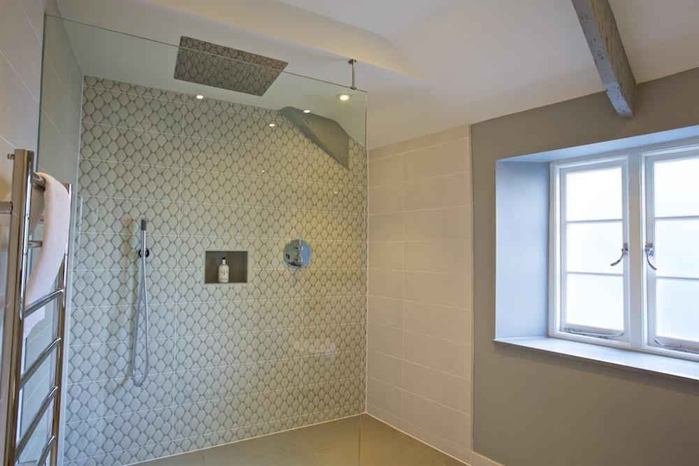 En suite with ceiling-mounted rain head shower at Hillfield Farmhouse in , Hillfield, Dartmouth