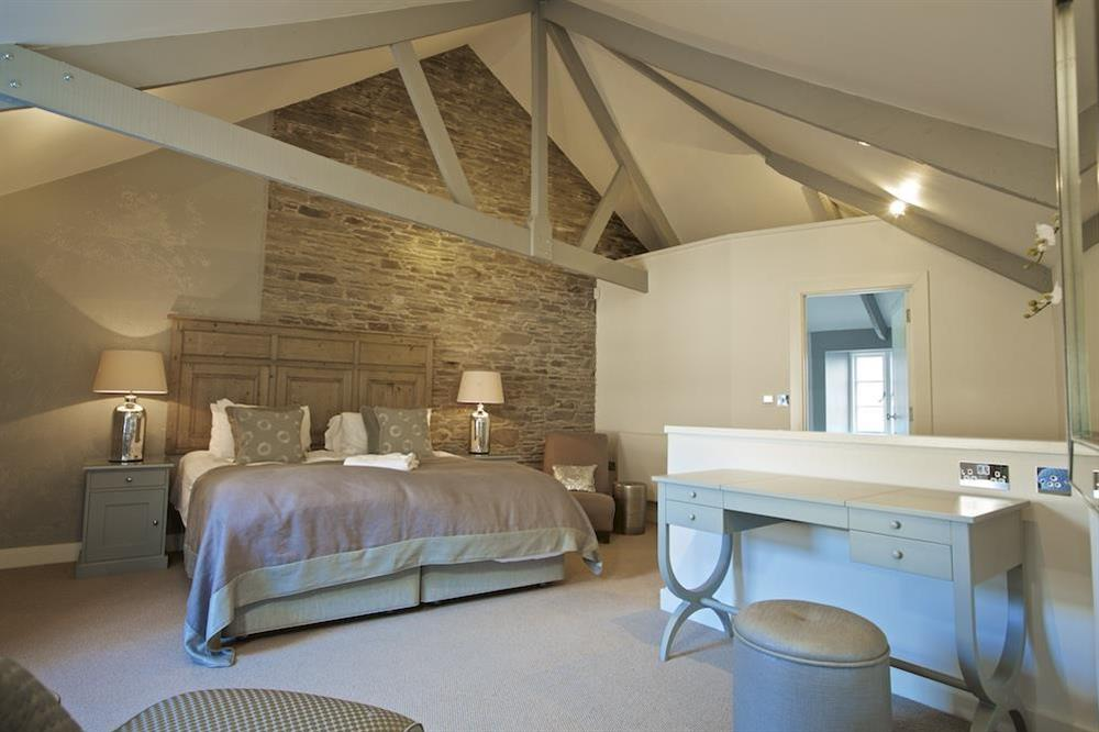 Master bedroom with original wooden cross beams at Hillfield Farmhouse in , Hillfield, Dartmouth