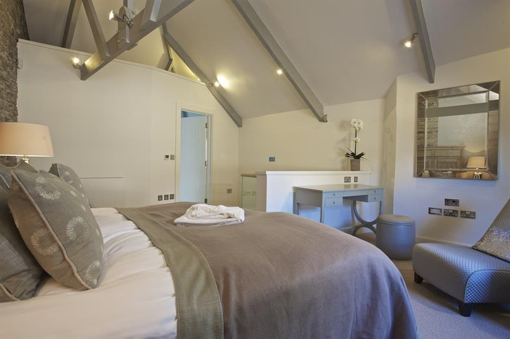 Master bedroom with super-King size bed at Hillfield Farmhouse in , Hillfield, Dartmouth