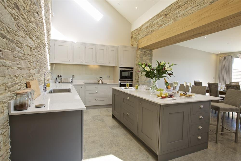 Open plan kitchen and dining room with striking original features at Hillfield Farmhouse in , Hillfield, Dartmouth