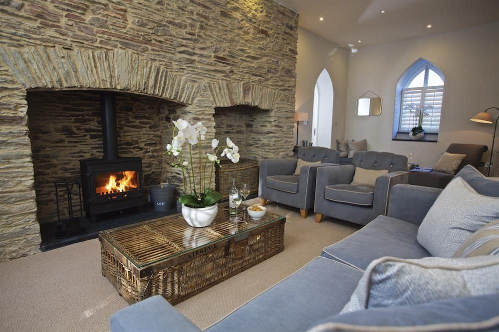 Sitting room complete with wood-burning stove at Hillfield Farmhouse in , Hillfield, Dartmouth