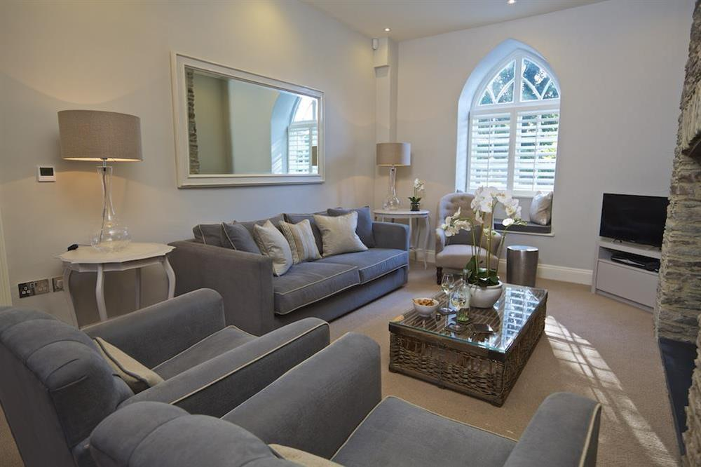 Sitting room with sofa, chairs and window seating at Hillfield Farmhouse in , Hillfield, Dartmouth