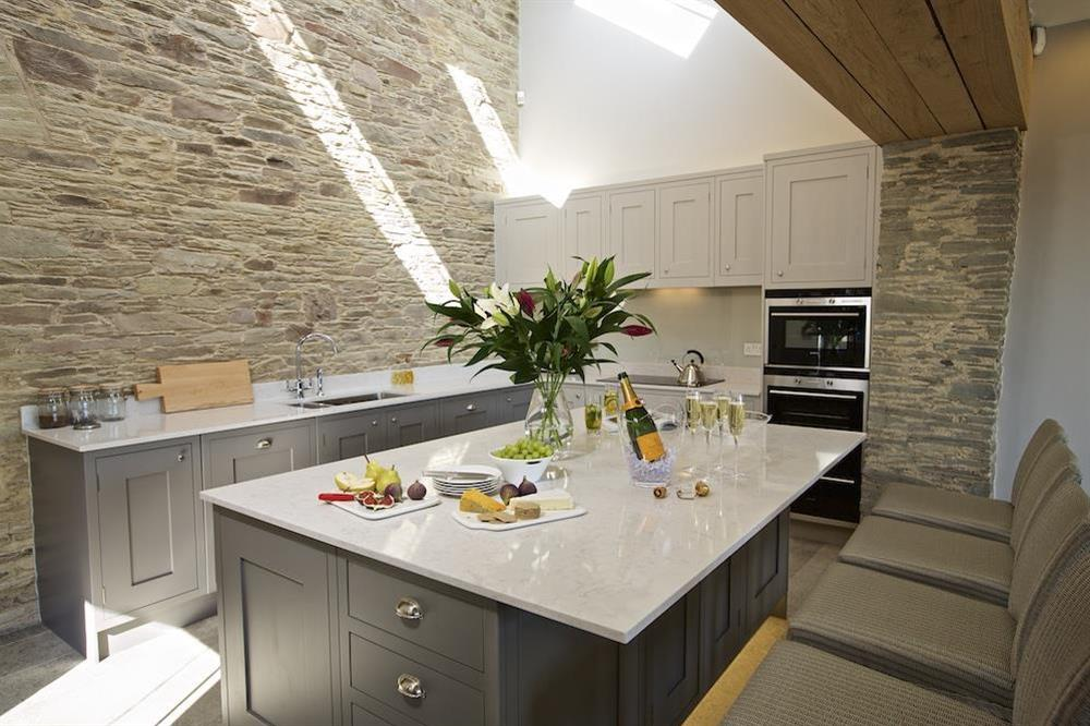 Very well equipped kitchen with large central island and breakfast bar at Hillfield Farmhouse in , Hillfield, Dartmouth