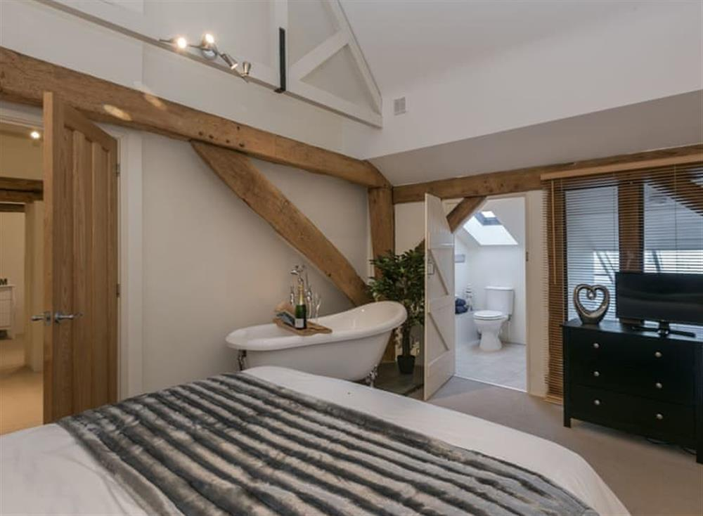 Master bedroom with roll-top bath (photo 2) at Holly Barn in Tacolneston, near Wymondham , Norfolk