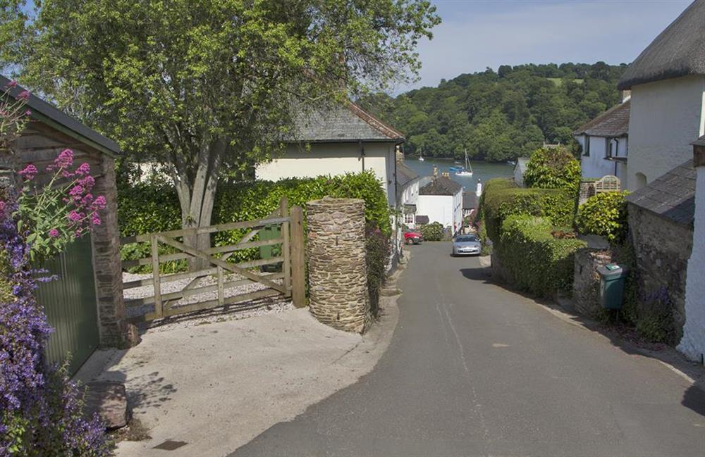 The gated driveway and  lane leading from Homelands down to the estuary and waterside pub at Homelands, Dittisham