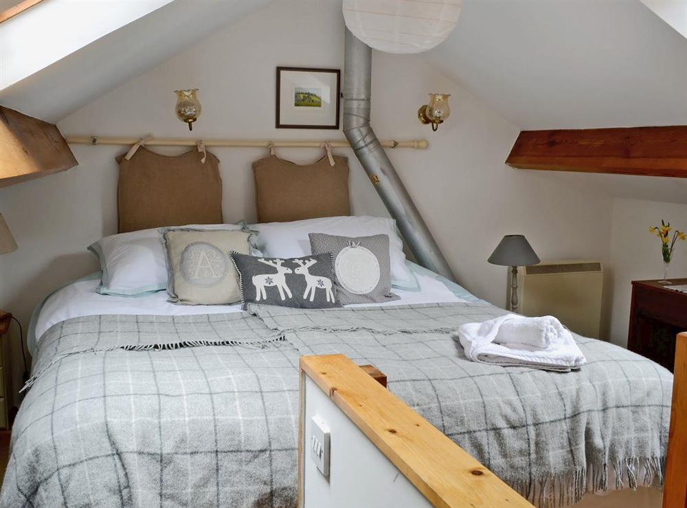 Galleried bedroom area with super king size bed at Honeysuckle Cottage in Mold, Clwyd