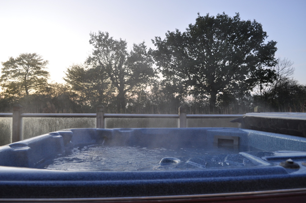 A hot tub at one of the lodges at Oakwood Lodges