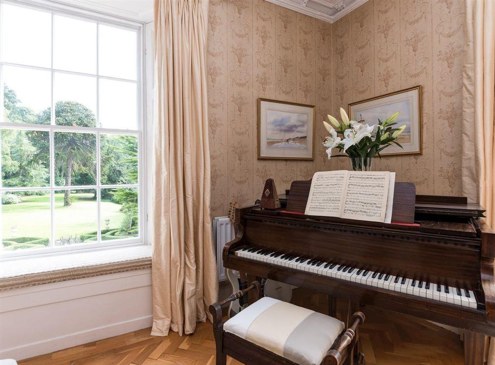 Baby grand piano at Howe Villa in Richmond, North Yorkshire