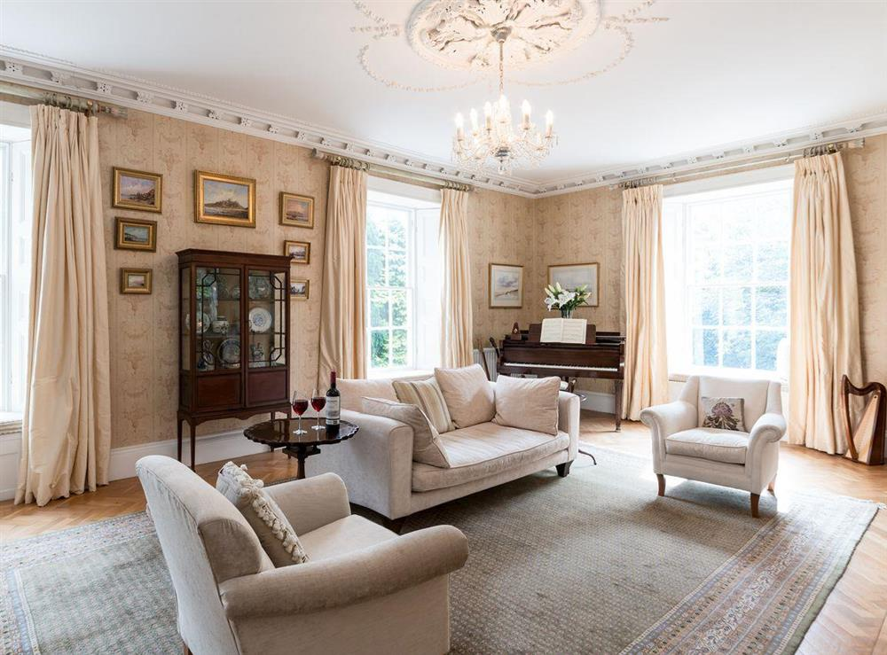 Drawing room with baby grand piano at Howe Villa in Richmond, North Yorkshire