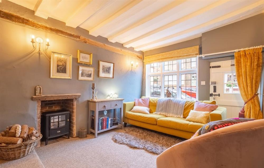 Ground floor: Sitting room with electric flame effect stove