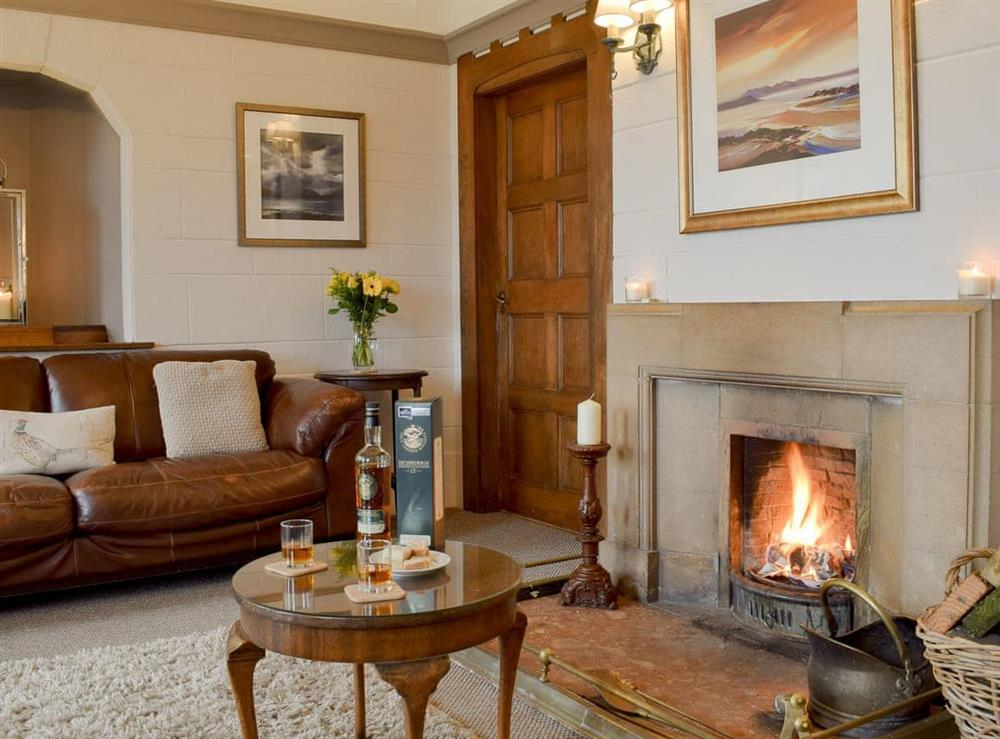 Charming living room with an open fire at The Lodge,