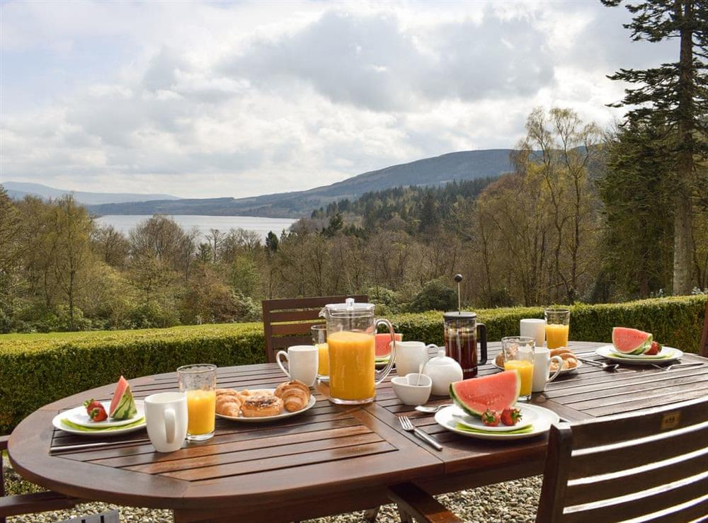 Outdoor eating area with spectacular views at The McGregor Apartment,