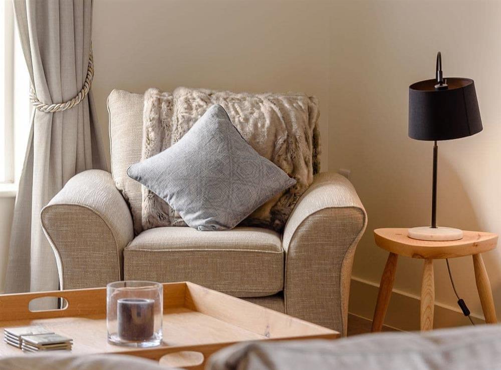 Cosy lounge area at Isolation Barn in Newbury, near Compton, Berkshire