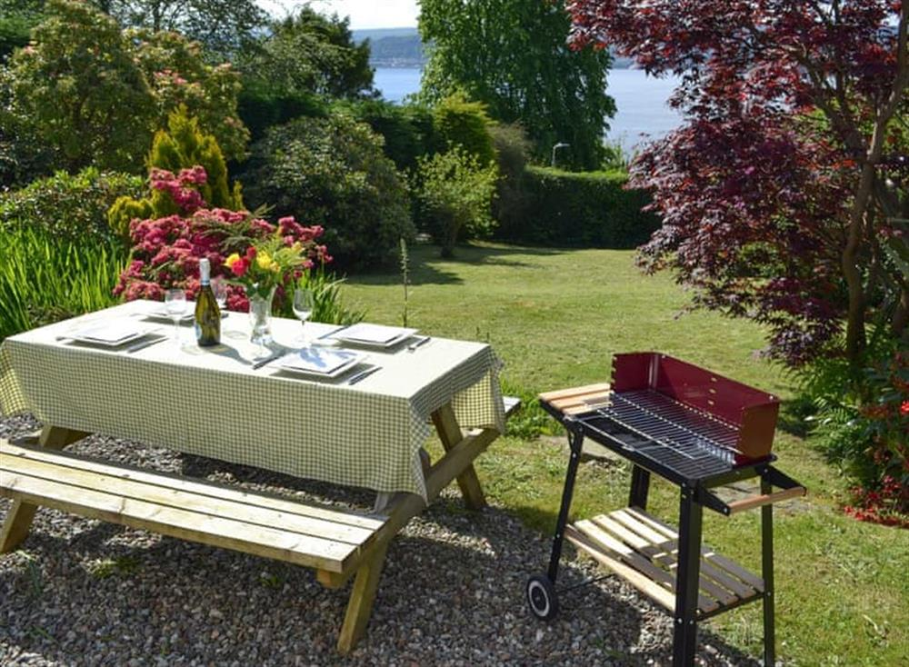 Patio area with views over the garden to the Firth of Clyde at Ivy Cottage in Kilcreggan, near Helensburgh, Dumbartonshire