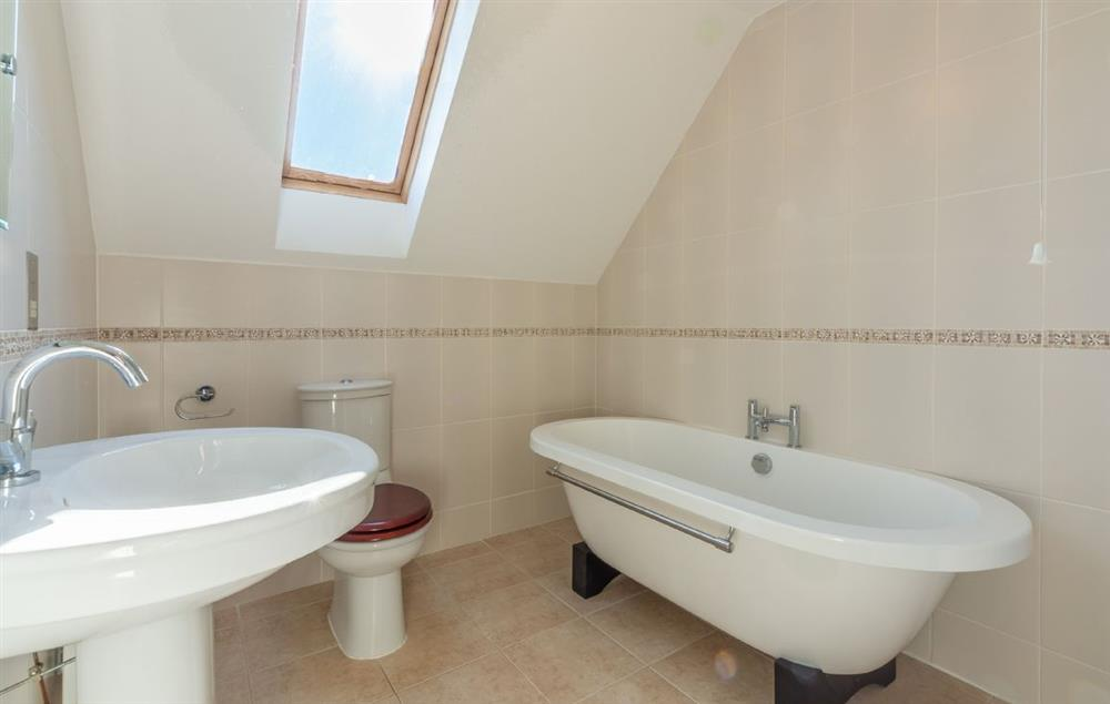 First floor:  En-suite with bath only