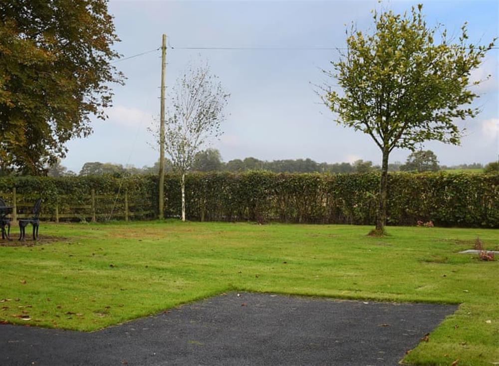 Large lawned area overlooking the adjacent fields and woodland
