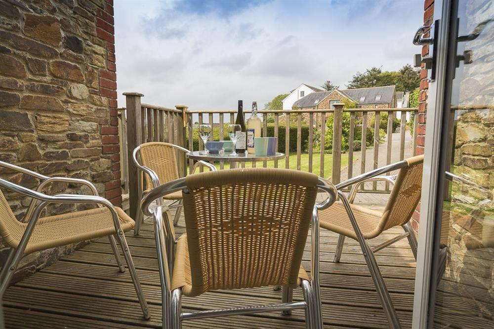 Furnished terrace with views of the Hillfield Village gardens (photo 2) at Keepers Cottage 4 in Hillfield, Dartmouth