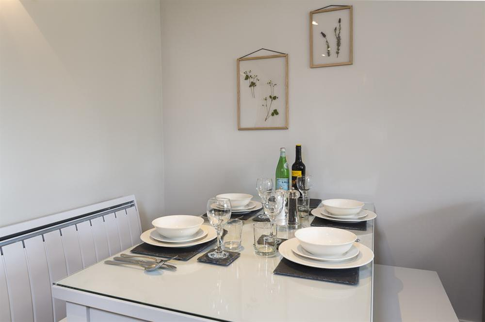 Dining table seating four (photo 2) at Keepers Cottage 5 in Hillfield, Dartmouth
