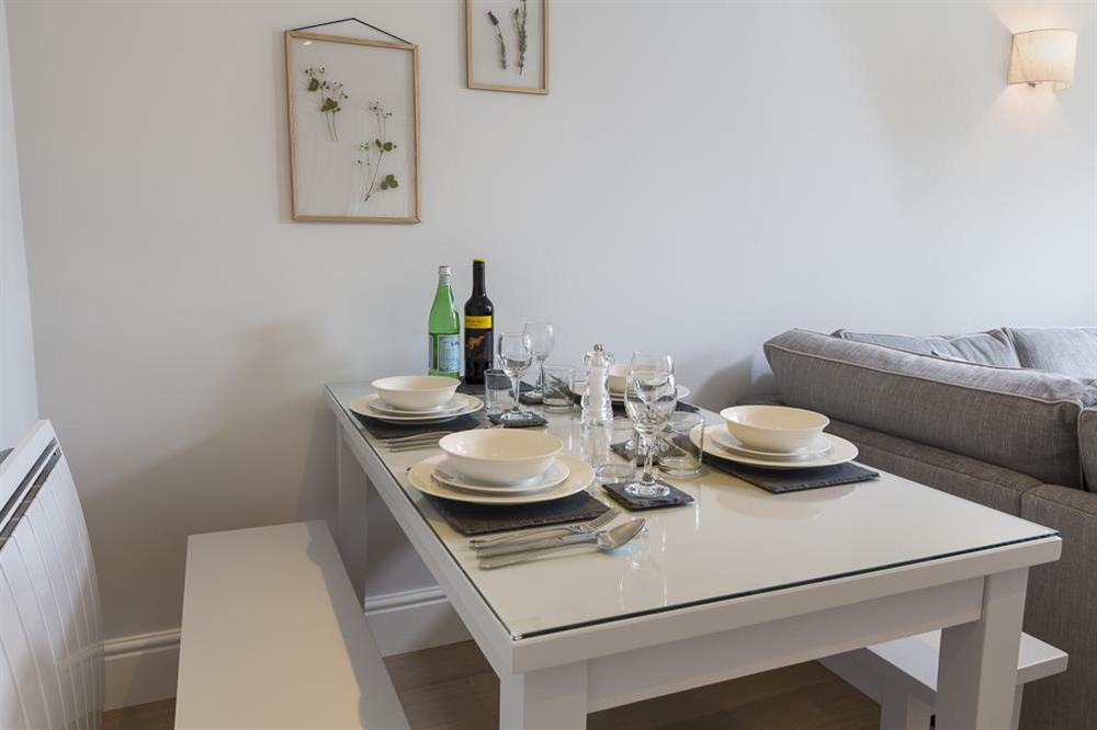 Dining table seating four at Keepers Cottage 5 in Hillfield, Dartmouth