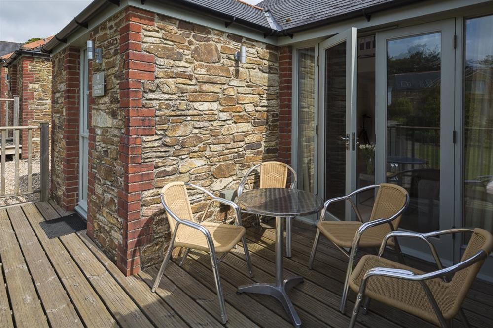 Furnished terrace with views of Hillfield Village gardens at Keepers Cottage 5 in Hillfield, Dartmouth