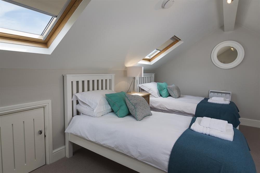 Gallery bedroom with two single beds at Keepers Cottage 5 in Hillfield, Dartmouth