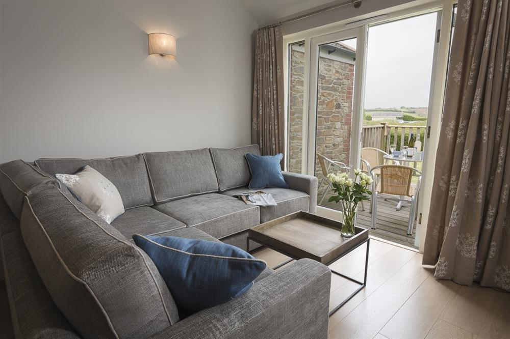 Living area leads out to a furnished terrace at Keepers Cottage 5 in Hillfield, Dartmouth