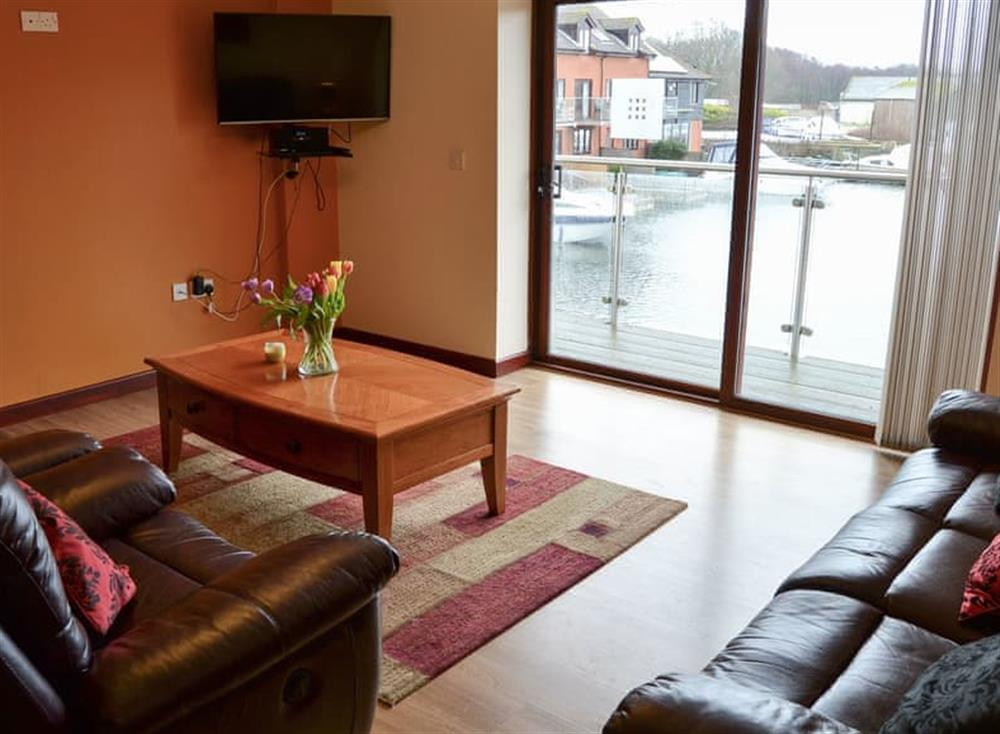 Lounge area with patio doors at Kestrel Cottage in Horning, near Wroxham, Norfolk