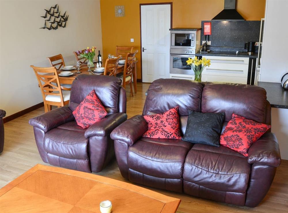 Open plan living space at Kestrel Cottage in Horning, near Wroxham, Norfolk