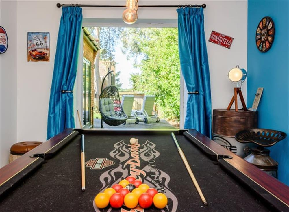 Entertaining games room at Kingfisher Lodge in Horning, Norfolk
