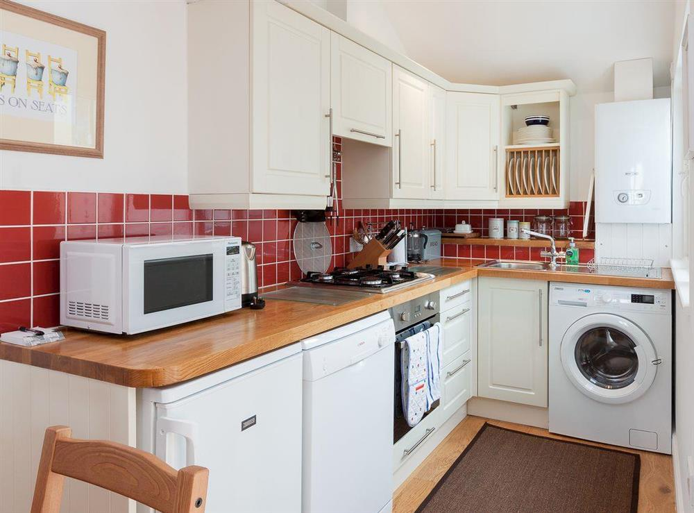 Fully equipped kitchen area at Kitkat Cottage in Dartmouth, Devon