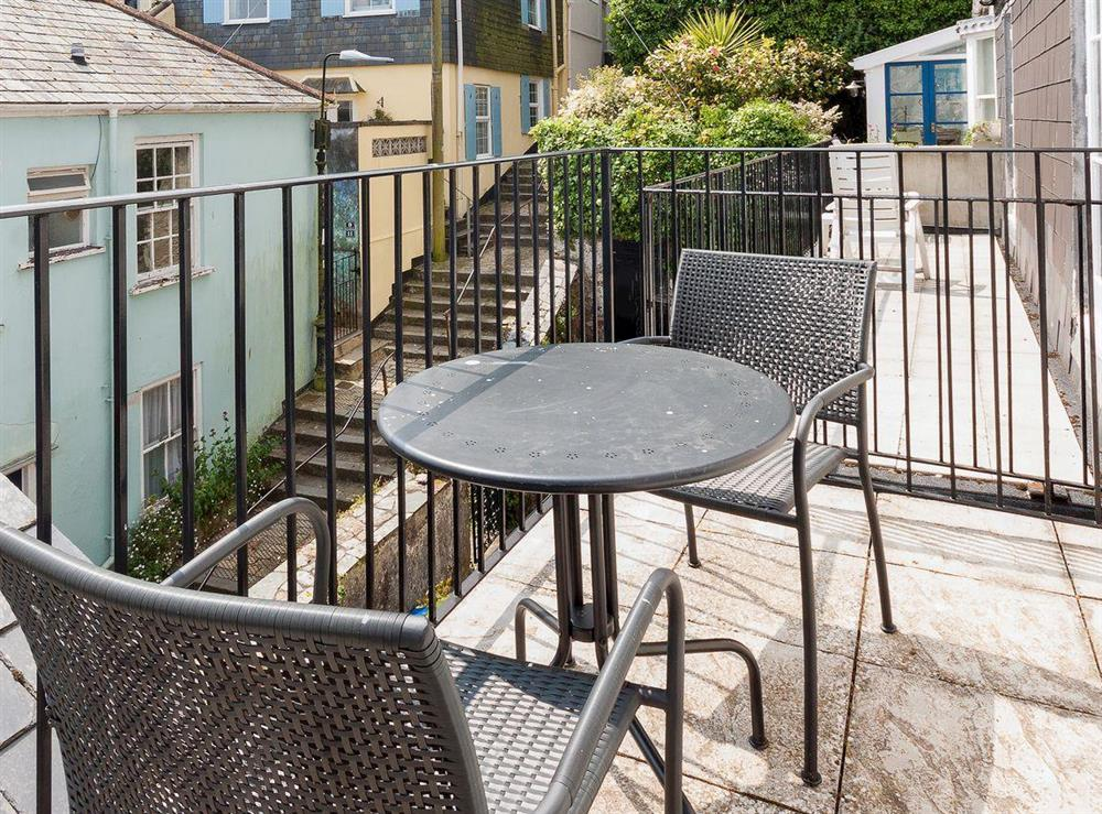 Sunny south-facing balcony at Kitkat Cottage in Dartmouth, Devon