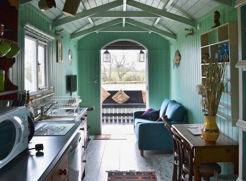 Open plan living/dining room/kitchen at Lakeside Hut in Gillingham, Dorset