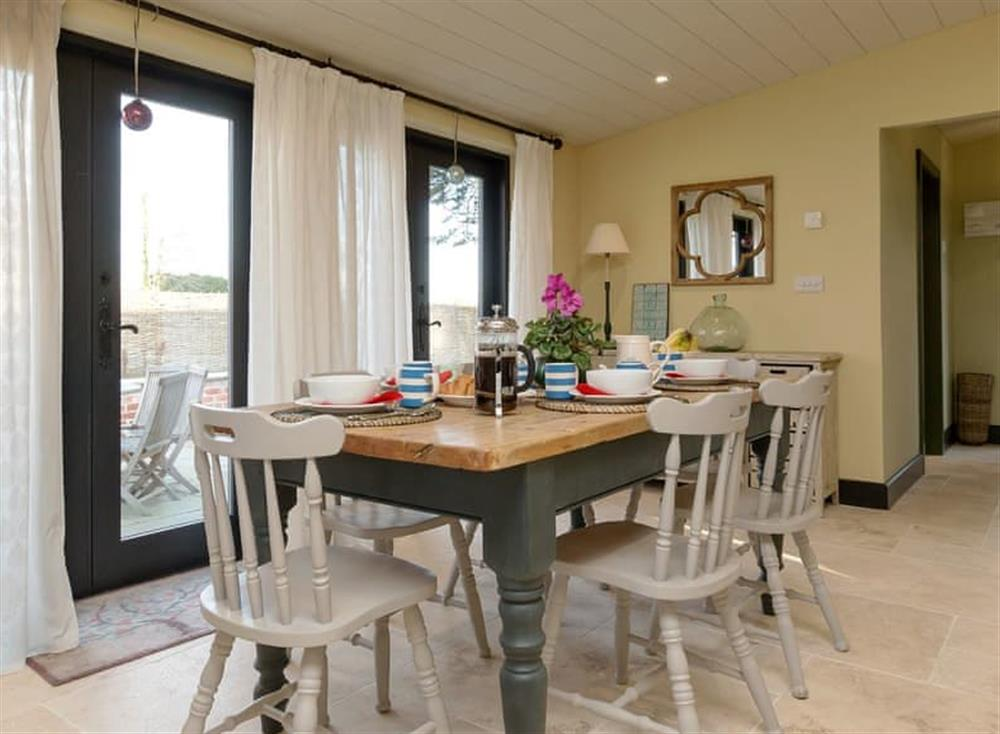 Light and airy dining area at Cedar Cottage,