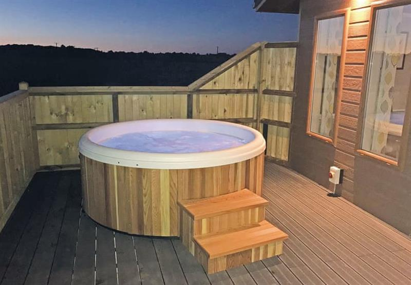 The outdoor hot tub in the Westfield Lodge at Larkrise Farm in Charlton Adam, Somerton