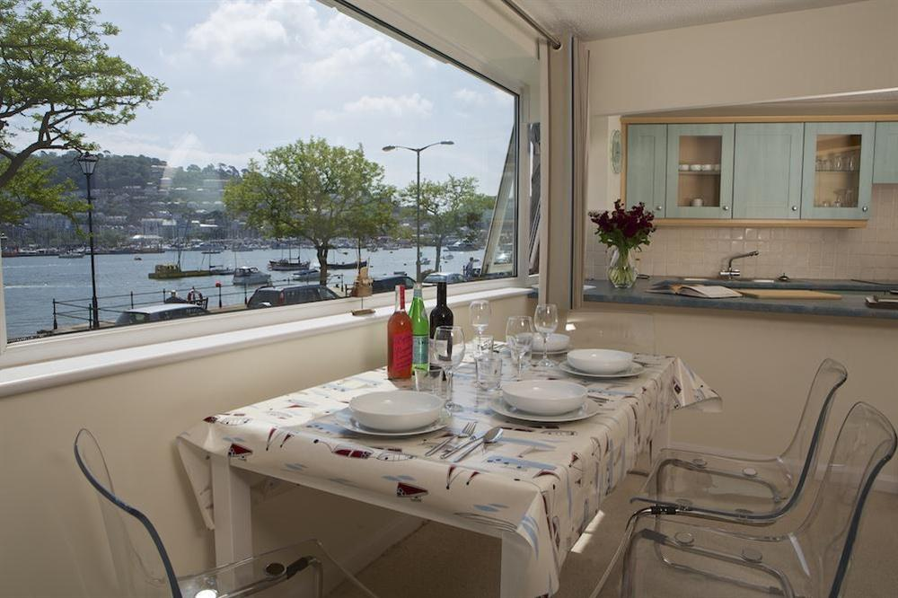 Enjoy views over the River Dart at the dining table, in the kitchen at Leeside in , Dartmouth