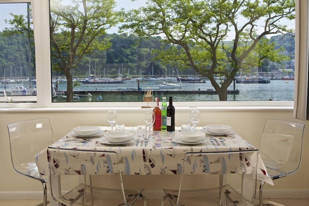 Enjoy views over the River Dart at the dining table at Leeside in , Dartmouth