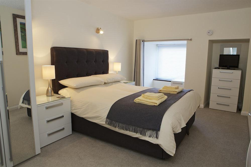 Master bedroom with King-size bed at Leeside in , Dartmouth