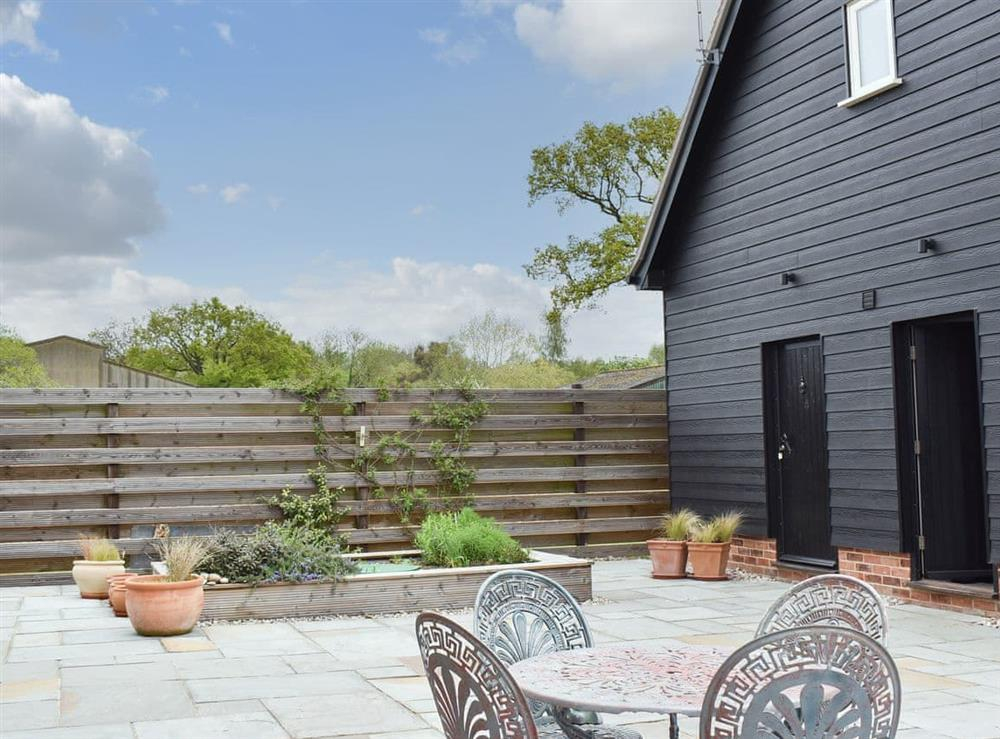 Patio at Leveret Lodge in Bures, Suffolk