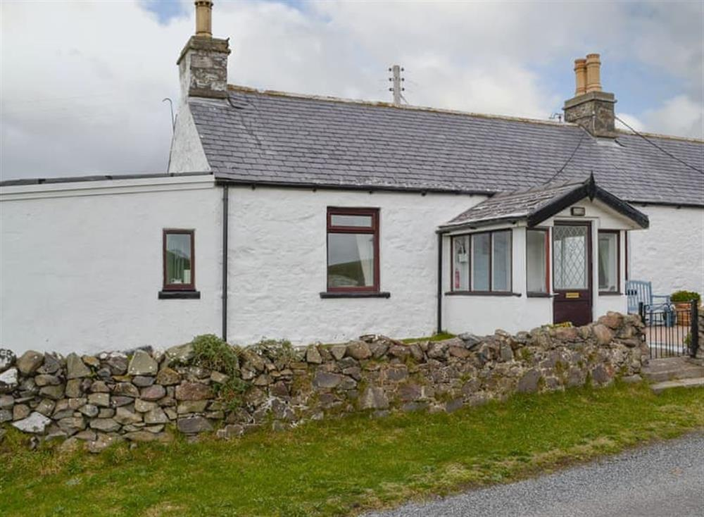 Traditional semi-detached Galloway cottage at Lighthouse View in Kirkcolm, Stranraer, Wigtownshire